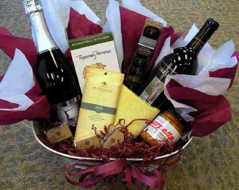 ... sparkling wine and a red or a white wine plus a spread, crackers, cheese, and chocolates! Yummy! Packed in either a gift box or gift basket.